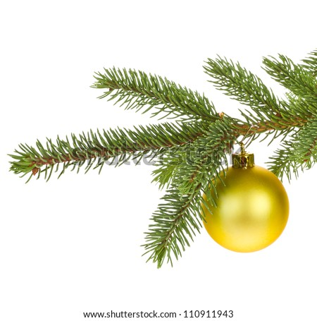 branch of Christmas tree with yellow glass ball  isolated on white background  concept of new year - stock photo