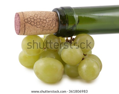 Branch of grapes and glass bottle      - stock photo