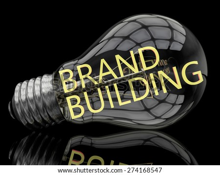 Brand Building - lightbulb on black background with text in it. 3d render illustration. - stock photo