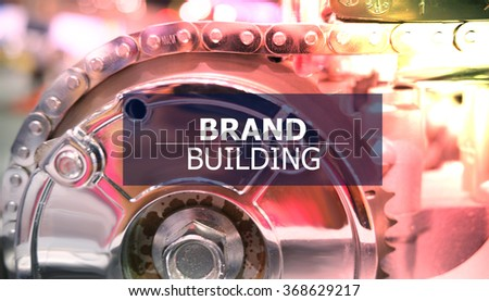 BRAND BUILDING on the Mechanism of Metal Cogwheels background , color filter image , innovation concept , business concept, business idea - stock photo