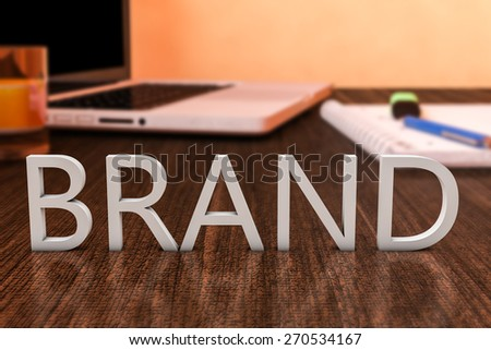 Brand - letters on wooden desk with laptop computer and a notebook. 3d render illustration. - stock photo