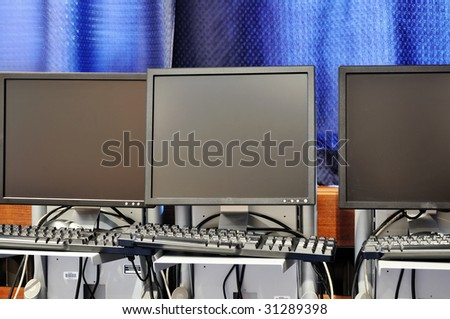 brand new computer with tft monitor in modern classroom at school - stock photo