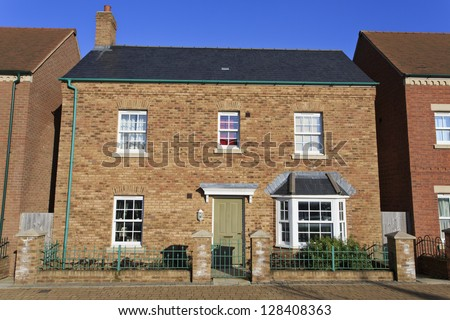 Brand new detached house with green door - stock photo