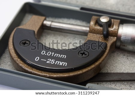 Brand new metal micrometer for the measuring. - stock photo