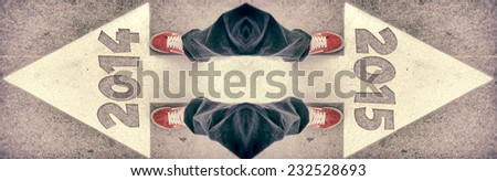 Brand new red shoes from above standing on 2014 and 2015 sign - stock photo