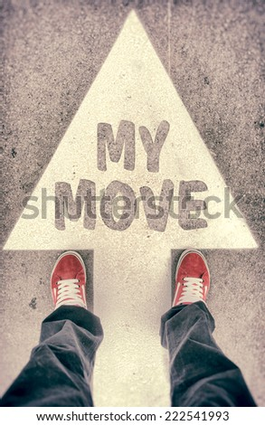 Brand new red shoes from above standing on my move sign - stock photo