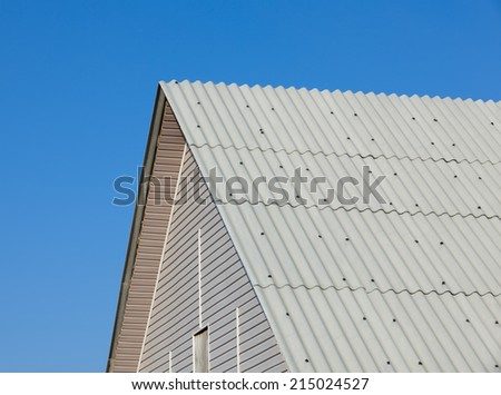 Brand new roof slate roofing against blue sky  - stock photo
