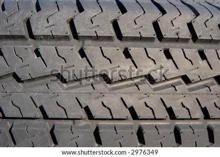 brand new tire close-up - stock photo