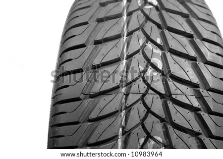 Brand new tire pattern on white background - stock photo