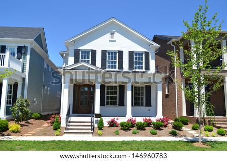 Brand New White Suburban American Dream Home with Large Front Porch - stock photo