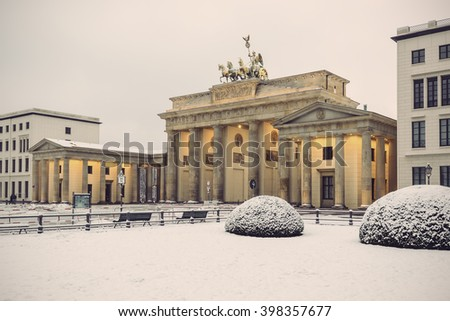 Brandenburg gate (Brandenburger Tor) in snow, Berlin, Germany, Europe, Vintage filtered style  - stock photo