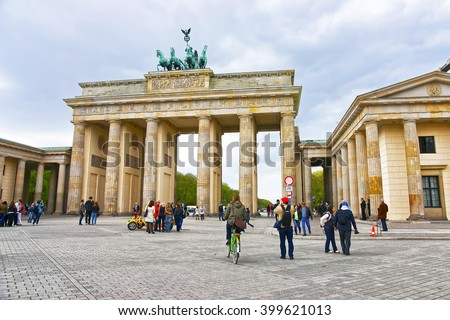 Brandenburg Gate in Berlin in Germany. The Brandenburg Gate is a triumphal arch, a city gate in the center of Berlin. It is one of the most known sites in Berlin. - stock photo