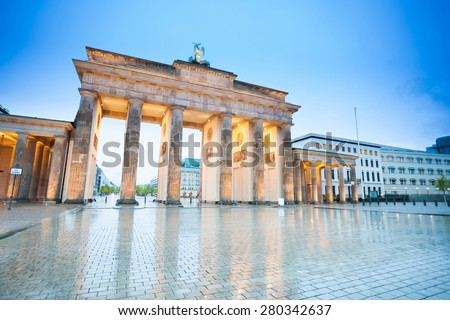 Branderburger Tor view at night with lights after rain in Berlin, Germany - stock photo