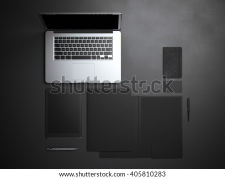 Branding mockup with laptop and tablet in dark studio. 3d rendering - stock photo