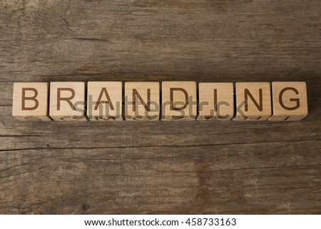 branding text on wooden cubes - stock photo