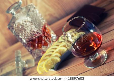brandy alcohol set glass and carafe  - stock photo