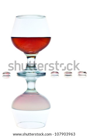 Brandy glass with reflection on white - stock photo