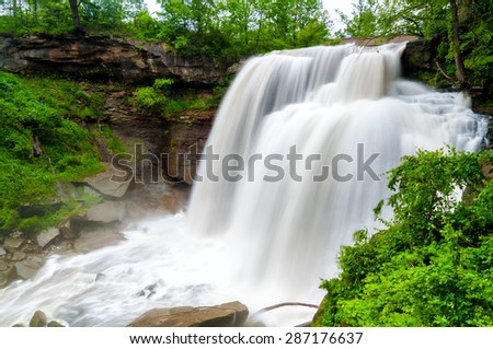 Brandywine Falls in Cuyahoga Valley National Park at full force after heavy spring rains, rendered silky with slow shutter exposure - stock photo