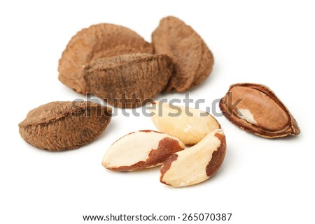 Brasil nuts in nutshell islated on white - stock photo