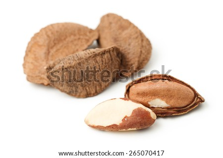 Brasil nuts in nutshell isolated on white - stock photo