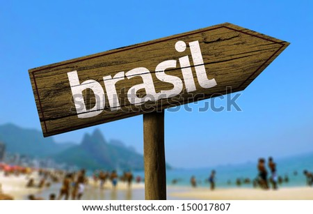 Brasil wooden sign with a beach on background - stock photo