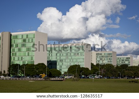 BRASILIA, BRAZIL - FEBRUARY 21: Row of ministry buildings of Brazil government on February 21, 2009 in Brasilia, Brazil. A famous example of modern urban planning by Oscar Niemeyer - stock photo