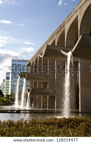 BRASILIA, BRAZIL - FEBRUARY 21:Waterfalls in front of Ministry of Justice building on February 21, 2009 in Brasilia, Brazil.It was designed by Oscar Niemeyer, one of the greatest architect in Brazil. - stock photo