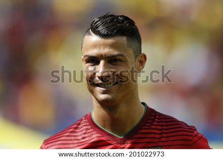 BRASILIA, BRAZIL - June 26, 2014: Cristiano Ronaldo of Portugal during the 2014 World Cup Group G game between Portugal and Ghana at Estadio Nacional Mane Garrincha. No Use in Brazil. - stock photo