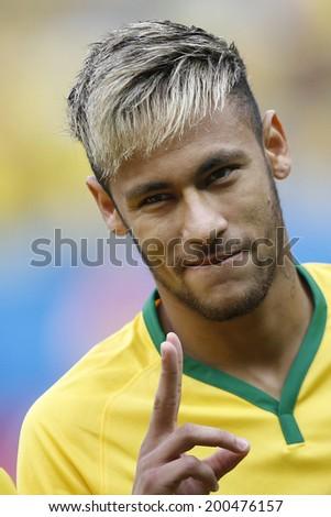 BRASILIA, BRAZIL - June 23, 2014: Neymar of Brazil during the 2014 World Cup Group A game between Brazil and Cameroon at Estadio Nacional Mane Garrincha. No Use in Brazil. - stock photo