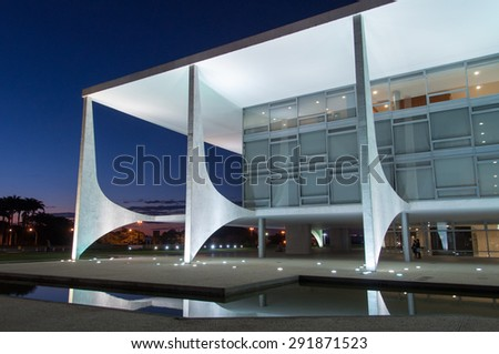 BRASILIA, BRAZIL - JUNE 3, 2015: Planalto Palace at night, a residence of the president of Brazil. It was designed by Oscar Niemeyer and completed in 1960. - stock photo