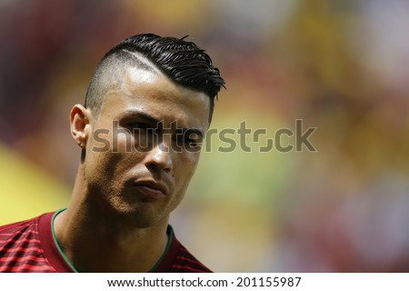 BRASILIA - JUNE 26, 2014: Cristiano Ronaldo on the FIFA World Cup 2014 Group G match between Ghana and Portugal in Estadio Nacional Mane Garrincha in Brasilia, Brazil. NO USE IN BRAZIL - stock photo