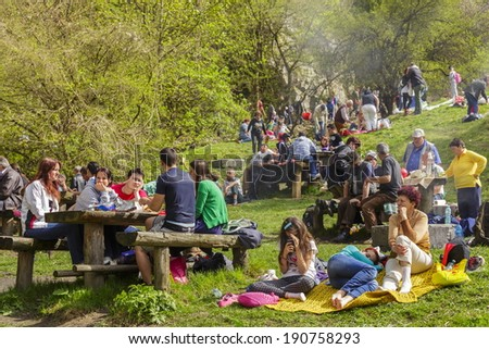 BRASOV, ROMANIA - APRIL 27: Unidentified people relax, socialize and picnic on weekends at Solomon's Stones gorge, a well known tourist attraction in Romania, on April 27, 2014 in Brasov, Romania. - stock photo