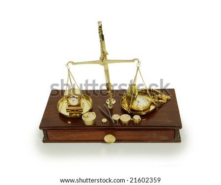 Brass and wood Scale used to weigh out small items, Gold pocket watch with a metal chain, small formal clock - stock photo