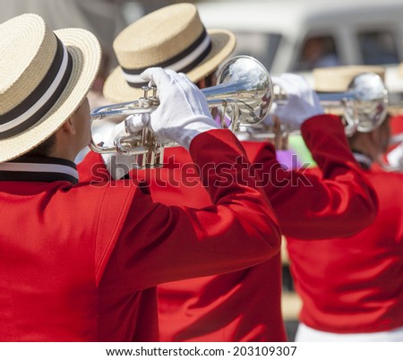 Brass Band in red uniform performing  - stock photo