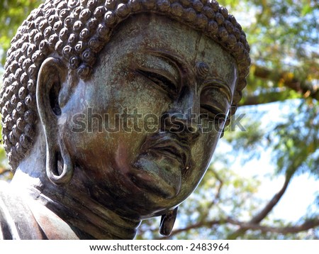 brass Buda at Hawaii Foster Botanical Garden gift from Japan - stock photo