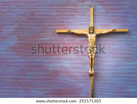 Brass Cross with crucified Jesus Christ on blue retro background  - stock photo