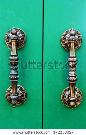 brass handle  with emerald door - stock photo