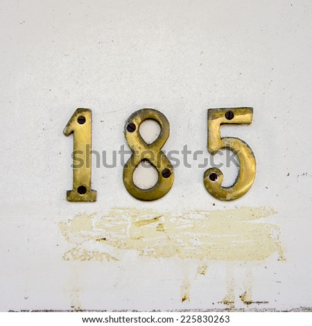 brass house number one hundred and eighty five. - stock photo
