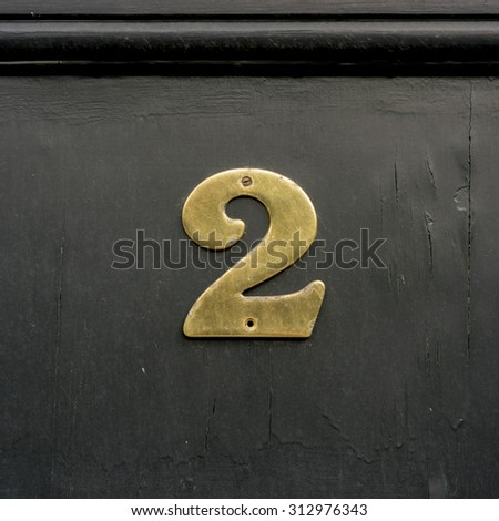 Brass house number two. - stock photo