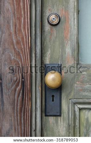 brass knob on wooden vintage door - stock photo