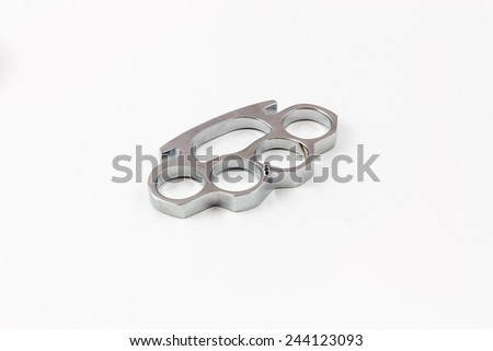 Brass knuckles weapon with white background - stock photo