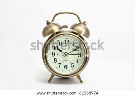 Brass metal alarm clock retro style. - stock photo