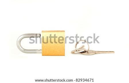 Brass padlock with key isolated on a white background - stock photo
