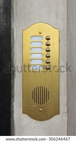 Brass Plated Doorbell Intercom Brass Device - stock photo
