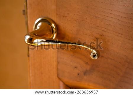 Brass polished door handle - stock photo