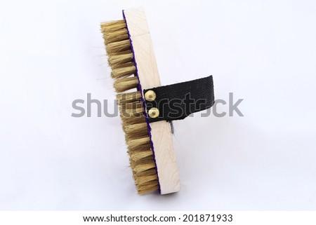Brass wire brush on white background - stock photo
