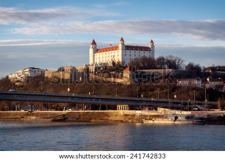 Bratislava Castle and slovak parliament above Danube river in Slovakia - stock photo