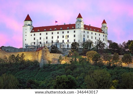 Bratislava Castle on the background of the pink clouds at sunset, Slovakia - stock photo
