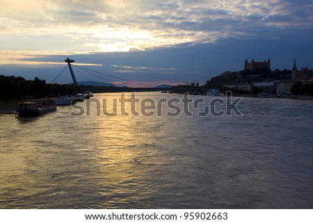 Bratislava castle with New Bridge over Danube River, Slovakia - stock photo