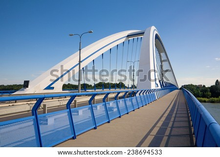 Bratislava - modern arched Apollo bridge - stock photo